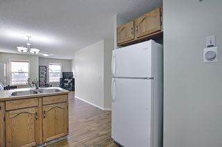 Photo 17: 154 WEST CREEK Bay: Chestermere Semi Detached for sale : MLS®# A1077510