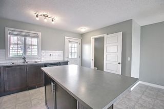 Photo 6: 166 PANTEGO Lane NW in Calgary: Panorama Hills Row/Townhouse for sale : MLS®# A1110965