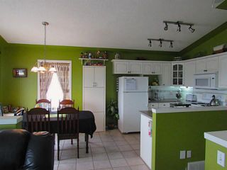 Photo 7: 106 CREEK GARDENS Place NW: Airdrie Residential Detached Single Family for sale : MLS®# C3606382