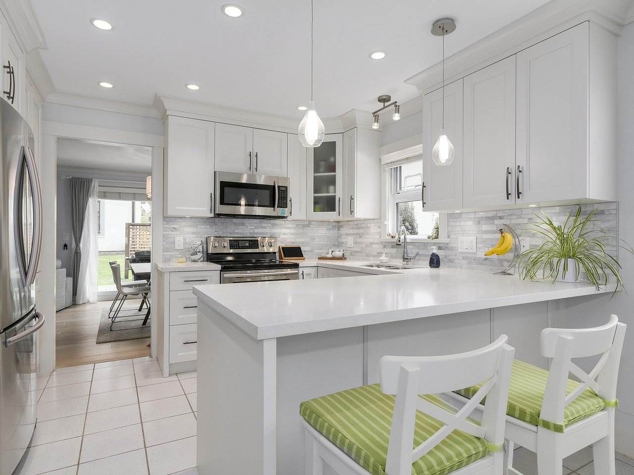 """Main Photo: 38 889 TOBRUCK Avenue in North Vancouver: Hamilton Townhouse for sale in """"TOBRUCK GARDENS"""" : MLS®# R2209623"""