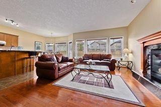 Photo 3: 1800 NEW BRIGHTON DR SE in Calgary: New Brighton House for sale : MLS®# C4220650