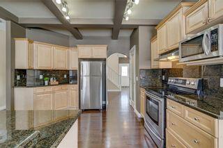 Photo 25: 204 SUNTERRA Boulevard: Cochrane House for sale : MLS®# C4164735