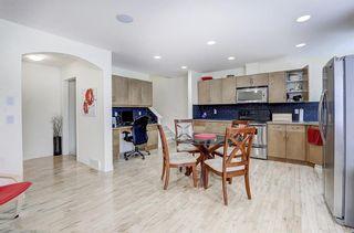 Photo 2: 3 EVERRIDGE Villa SW in Calgary: Evergreen Semi Detached for sale : MLS®# C4297700