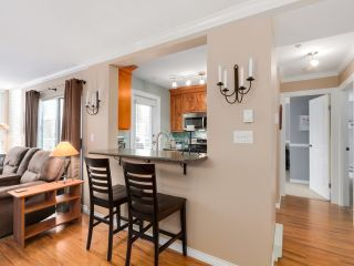 "Photo 5: 212 8450 JELLICOE Street in Vancouver: Fraserview VE Condo for sale in ""Boardwalk"" (Vancouver East)  : MLS®# R2037508"