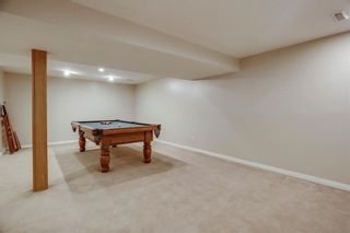 Photo 35: 74 SHAWNEE CR SW in Calgary: Shawnee Slopes House for sale : MLS®# C4226514