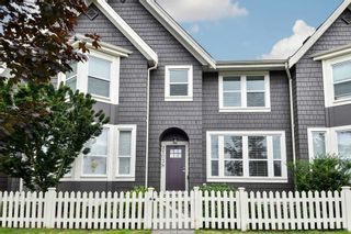 """Photo 1: 21038 77A Avenue in Langley: Willoughby Heights Condo for sale in """"IVY ROW"""" : MLS®# R2474522"""