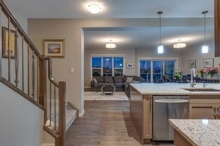 Photo 11: 157 Sunset Point: Cochrane Row/Townhouse for sale : MLS®# A1132458