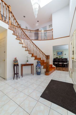 Photo 2: 4899 MOSS Street in Vancouver: Collingwood VE House for sale (Vancouver East)  : MLS®# R2566068