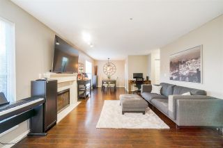 "Photo 1: 108 20350 54 Avenue in Langley: Langley City Condo for sale in ""Coventry Gate"" : MLS®# R2540145"