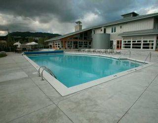 "Photo 1: 500 KLAHANIE Drive in Port Moody: Port Moody Centre Condo for sale in ""TIDES"" : MLS®# V608062"
