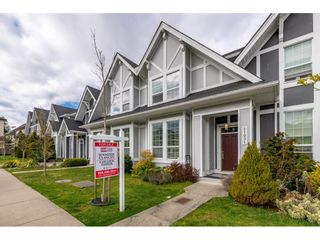 """Photo 1: 21031 79A Avenue in Langley: Willoughby Heights Condo for sale in """"Kingsbury at Yorkson South"""" : MLS®# R2448587"""