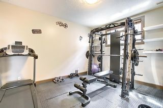 Photo 31: 353 RAINBOW FALLS Way: Chestermere Detached for sale : MLS®# A1122642