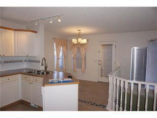 Photo 5: 208 TARINGTON Close NE in Calgary: Taradale House for sale : MLS®# C4040082