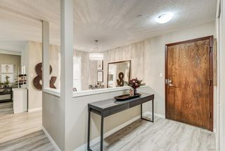 Photo 2: 104 3719B 49 Street NW in Calgary: Varsity Apartment for sale : MLS®# A1129174