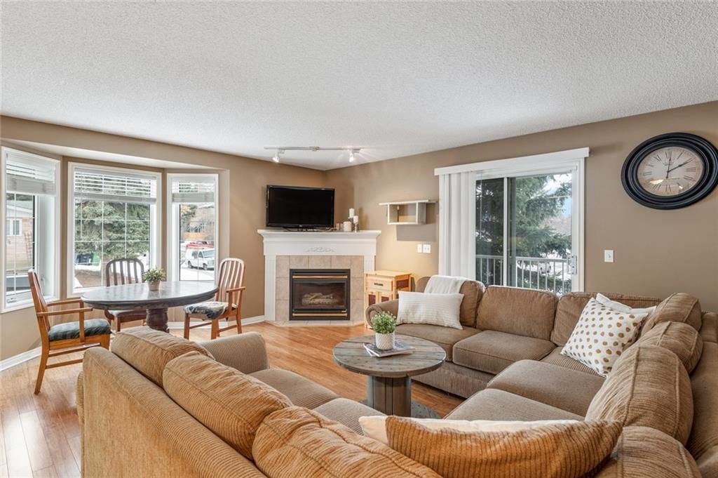 Bright open living and dining area. Note bay window to the west sits up and overlooks 1 St. SW, which is quiet.  Balcony for BBQ. Fireplace Natural Gas.