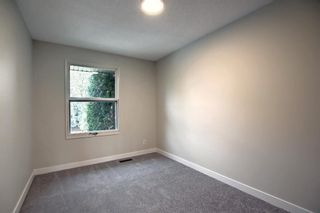 Photo 19: 77 123 Queensland Drive SE in Calgary: Queensland Row/Townhouse for sale : MLS®# A1145434