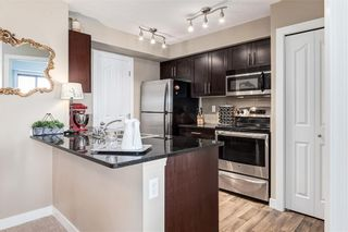 Photo 4: 4407 403 MACKENZIE Way SW: Airdrie Apartment for sale : MLS®# C4195055