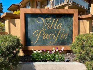 "Photo 1: 113 15155 22 Avenue in Surrey: Sunnyside Park Surrey Condo for sale in ""Villa Pacific"" (South Surrey White Rock)  : MLS®# R2576826"