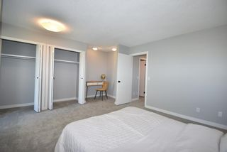 Photo 19: 5 903 67 Avenue SW in Calgary: Kingsland Row/Townhouse for sale : MLS®# A1115343