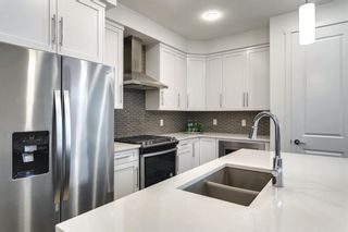 Photo 16: 618 148 Avenue NW in Calgary: Livingston Detached for sale : MLS®# A1149681
