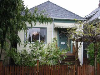 Photo 1: 1613 E 4TH Avenue in Vancouver: Grandview VE House for sale (Vancouver East)  : MLS®# V871618