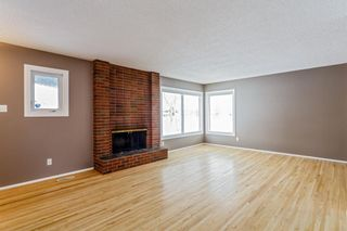Photo 5: 608 Willacy Drive SE in Calgary: Willow Park Detached for sale : MLS®# A1050257