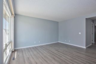 Photo 4: 514 200 Brookpark Drive SW in Calgary: Braeside Row/Townhouse for sale : MLS®# A1094257