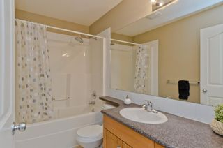 Photo 21: 205 2006 LUXSTONE Boulevard SW: Airdrie Row/Townhouse for sale : MLS®# A1010440