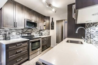 "Photo 7: 103 1935 W 1ST Avenue in Vancouver: Kitsilano Condo for sale in ""KINGSTON GARDENS"" (Vancouver West)  : MLS®# R2249409"