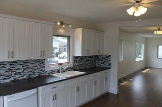 Photo 5: 1014 Nanton Avenue: Crossfield House for sale : MLS®# C4123826