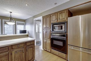 Photo 10: 607 Stratton Terrace SW in Calgary: Strathcona Park Row/Townhouse for sale : MLS®# A1065439