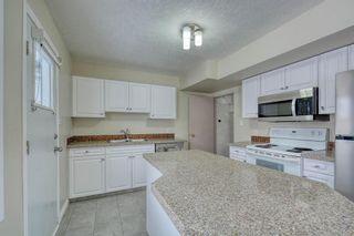 Photo 19: 231 Regal Park NE in Calgary: Renfrew Row/Townhouse for sale : MLS®# A1068574