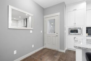 Photo 4: 2 4726 17 Avenue NW in Calgary: Montgomery Row/Townhouse for sale : MLS®# A1116859
