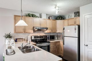 Photo 7: 30 33 Stonegate Drive NW: Airdrie Row/Townhouse for sale : MLS®# A1117438