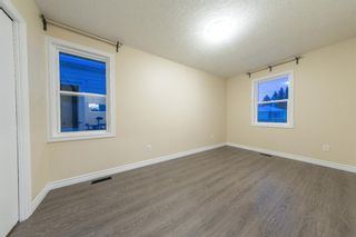 Photo 4: 129 20 Avenue NE in Calgary: Tuxedo Park Detached for sale : MLS®# A1066755