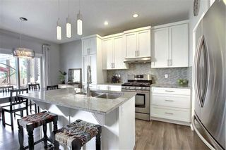 Photo 2: 1023 BRIGHTONCREST Green SE in Calgary: New Brighton Detached for sale : MLS®# A1014253