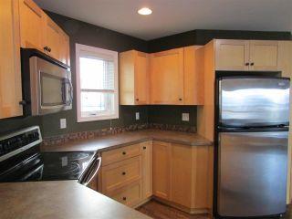 """Photo 4: 8828 113 Avenue in Fort St. John: Fort St. John - City NE House for sale in """"PANORAMA RIDGE"""" (Fort St. John (Zone 60))  : MLS®# R2254980"""