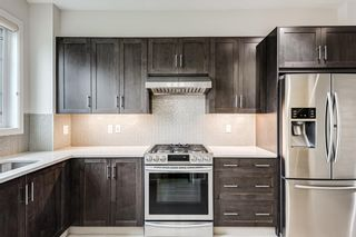 Photo 2: 30 Sherwood Row NW in Calgary: Sherwood Row/Townhouse for sale : MLS®# A1136563
