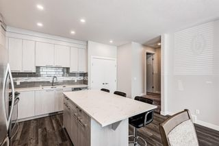 Photo 7: 125 Redstone Crescent NE in Calgary: Redstone Row/Townhouse for sale : MLS®# A1124721