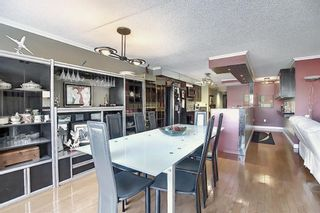 Photo 7: 806 320 Meredith Road NE in Calgary: Crescent Heights Apartment for sale : MLS®# A1143492