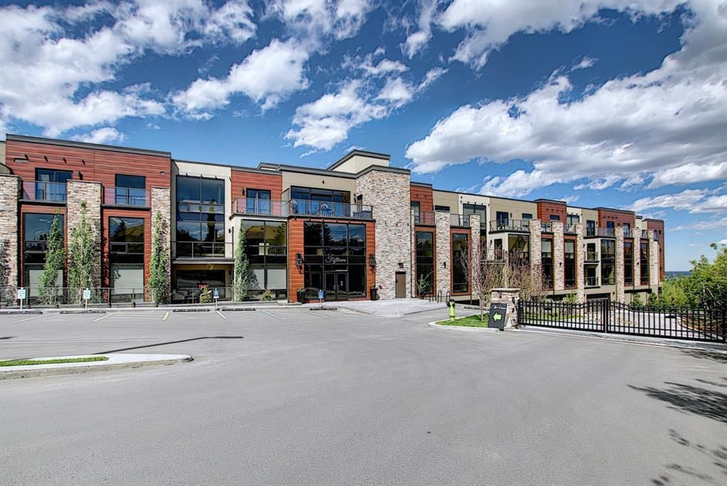 Main Photo: 214 15 Cougar Ridge Landing SW in Calgary: Patterson Apartment for sale : MLS®# A1095933