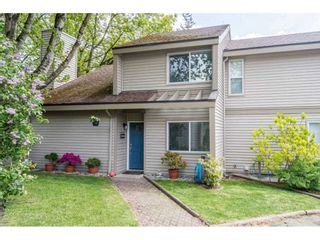 """Photo 1: 6036 W GREENSIDE Drive in Surrey: Cloverdale BC Townhouse for sale in """"Greenside Estates"""" (Cloverdale)  : MLS®# R2588441"""