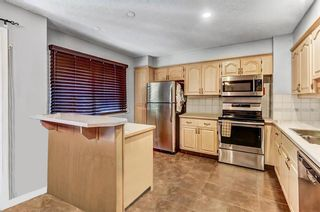 Photo 3: 53 3302 50 Street NW in Calgary: Varsity Row/Townhouse for sale : MLS®# A1088935