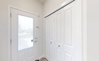 Photo 2: 405 Carringvue Avenue NW in Calgary: Carrington Semi Detached for sale : MLS®# A1087749