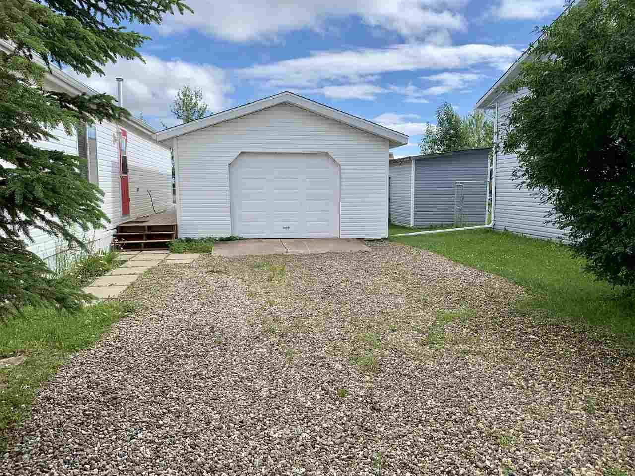 """Photo 21: Photos: 3935 COTTONWOOD Road in Fort Nelson: Fort Nelson -Town Manufactured Home for sale in """"EAST DUB"""" (Fort Nelson (Zone 64))  : MLS®# R2479630"""