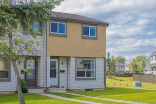 Photo 2: 98 2720 Rundleson Road NE in Calgary: Rundle Row/Townhouse for sale : MLS®# A1075700