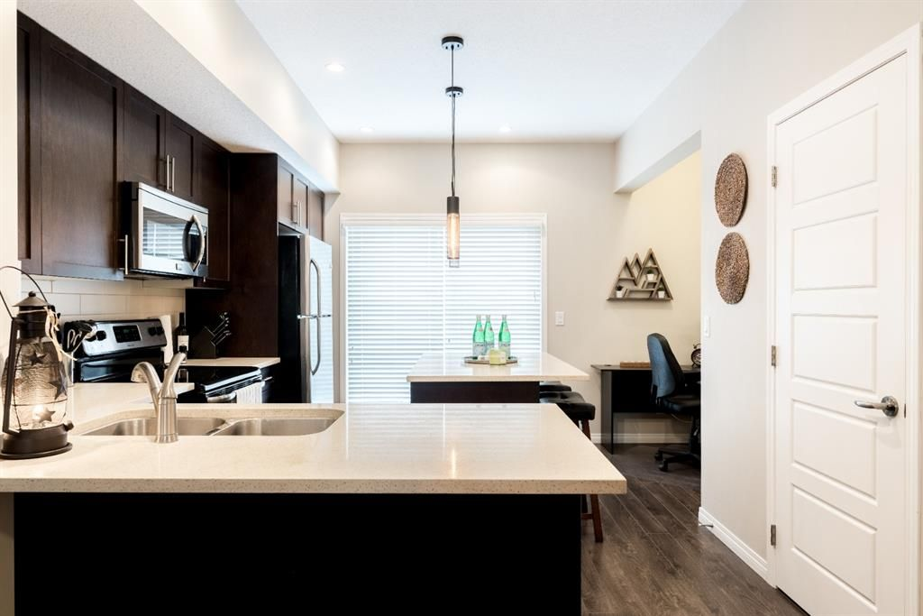Photo 8: Photos: 605 280 Williamstown Close NW: Airdrie Row/Townhouse for sale : MLS®# A1048279