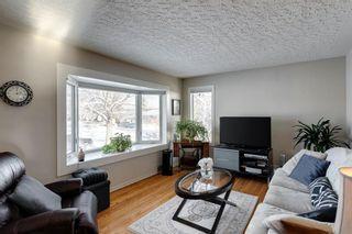 Photo 4: 855 13 Avenue NE in Calgary: Renfrew Detached for sale : MLS®# A1064139