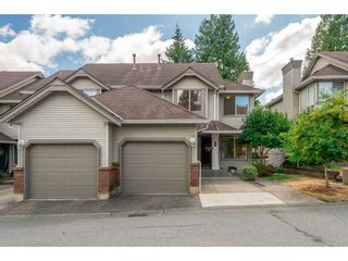 """Photo 1: 210 13900 HYLAND Road in Surrey: East Newton Townhouse for sale in """"Hyland Grove"""" : MLS®# R2295690"""