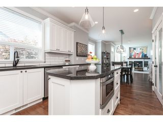 """Photo 14: 7089 179 Street in Surrey: Cloverdale BC House for sale in """"Provinceton"""" (Cloverdale)  : MLS®# R2492815"""